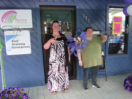 Gerri and Jen cut the ribbon
